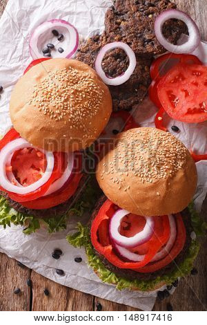 Sandwich With Burgers From Beans And Vegetables Close-up. Vertical Top View