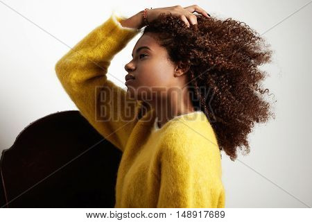 Woman Touching Her Big Curly Afro Hair