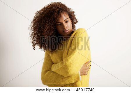 freezed black woman wears the flyffy sweater