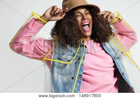 Autumn Style Black Woman Wears Transparent Raincoat And Bright Clothes