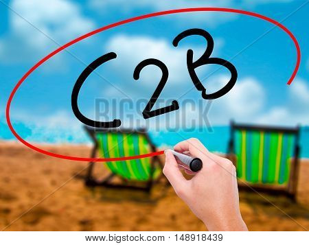 Man Hand Writing C2B With Black Marker On Visual Screen