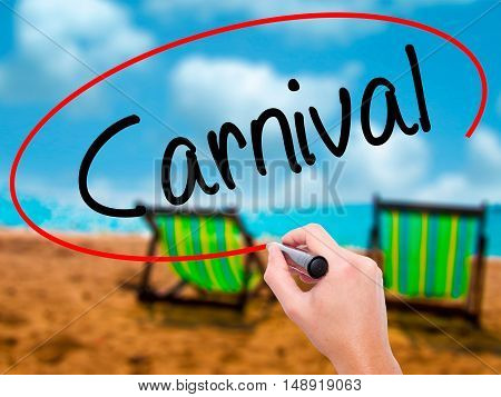 Man Hand Writing Carnival With Black Marker On Visual Screen