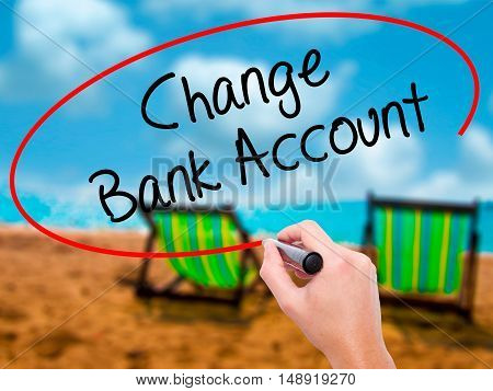 Man Hand Writing Change Bank Account With Black Marker On Visual Screen