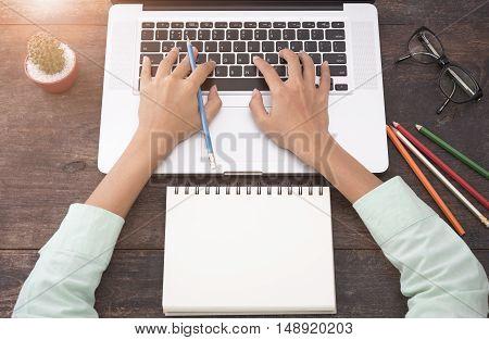 Businesswomen using computer with hands typing keyboard on desk work.
