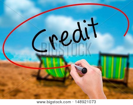Man Hand Writing Credit With Black Marker On Visual Screen