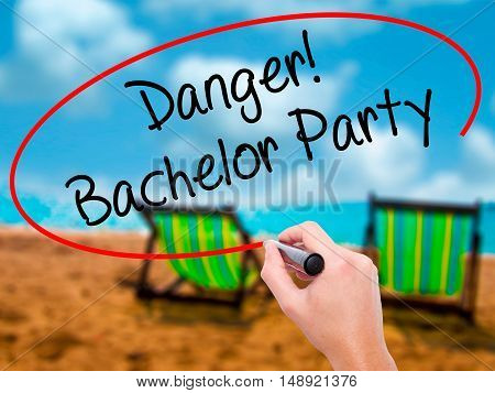 Man Hand Writing Danger! Bachelor Party With Black Marker On Visual Screen