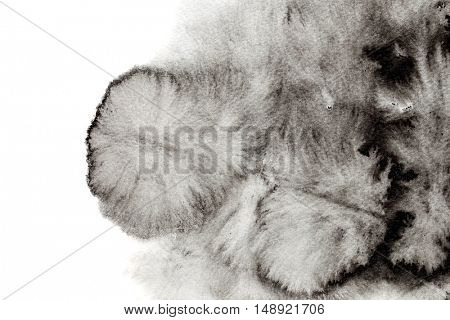 Black formless watercolor stain isolated over the white background