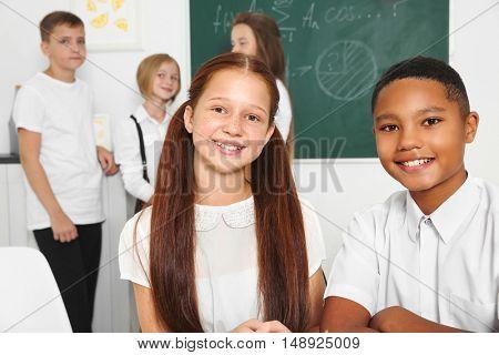 Schoolchildren in classroom during lesson