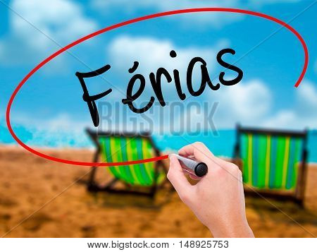 Man Hand Writing FÃ?rias (holidays In Portuguese) With Black Marker On Visual Screen