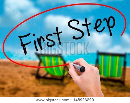 Man Hand Writing First Step  With Black Marker On Visual Screen