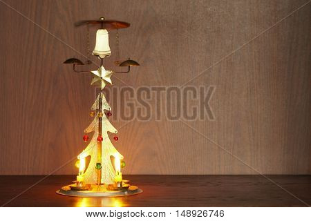 Antique golden metallic christmas candle stick shaped tree