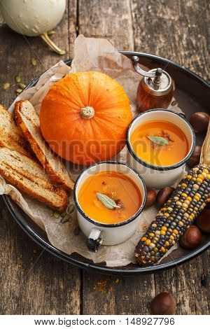 Roasted pumpkin and carrot soup. Autumn food. Vegetables soup.