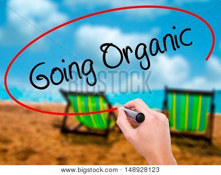 Man Hand Writing Going Organic With Black Marker On Visual Screen