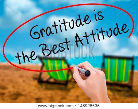 Man Hand Writing Gratitude Is The Best Attitude With Black Marker On Visual Screen