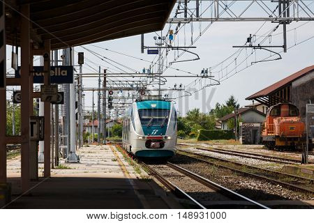 Cittadella Italy - May 05 2016: The passenger train arrives at Railroad Station spring time