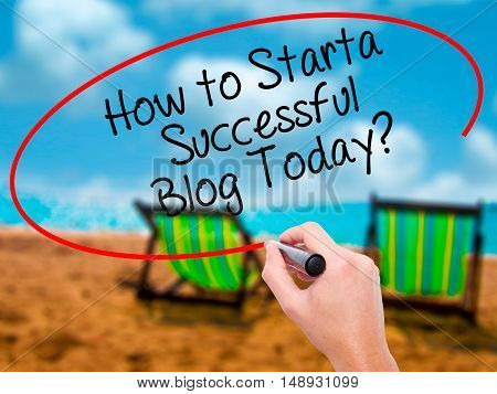 Man Hand Writing How To Start A Successful Blog Today? With Black Marker On Visual Screen