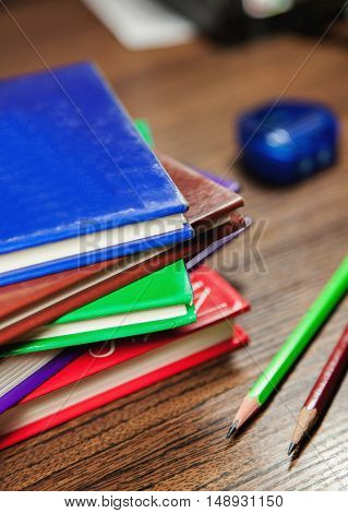 Colored Books Stacked On Wooden Table