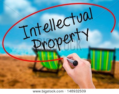 Man Hand Writing Intellectual Property With Black Marker On Visual Screen