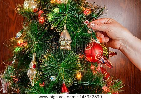 Decorating christmas tree with vintage christmas decorations