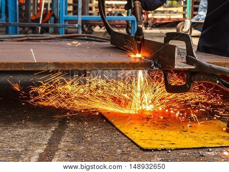 Sparks while cutting steel in the factory