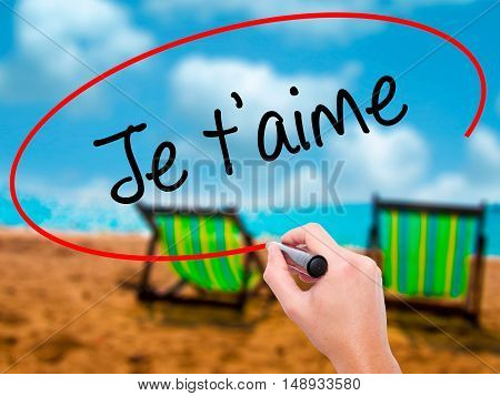 Man Hand Writing Je T'aime ( I Love You In French)  With Black Marker On Visual Screen