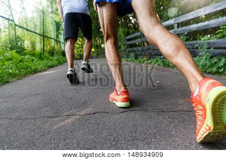 Closeup of running shoes and legs in action. Marathon