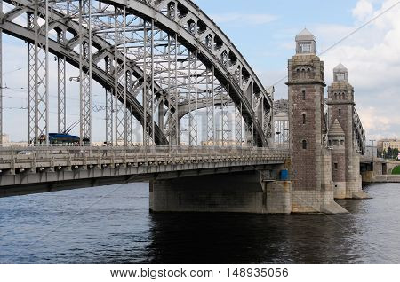Historic bridge of Emperor Peter the Great over river Neva in Saint-Petersburg,  later name - Bolsheohtinsky. Three-span metal bridge, central part is adjustable. Towers - govern divorce of bridge.