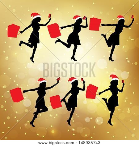 Silhouettes of christmas shopping women hoding their paperbag and credit card