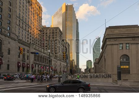TORONTO,CANADA-AUGUST 2,2015:view of the skyscrapers in Toronto during a sunset from one of the central street of the city near the union station.