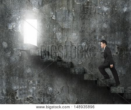 Businessman Climbing Concrete Stairs Toward Door With Bright Light.