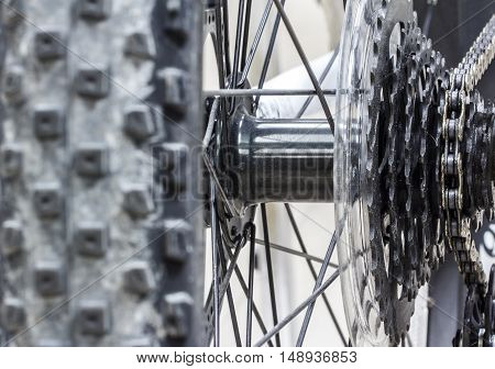 The Bicycle gear road metal cogwheel spots