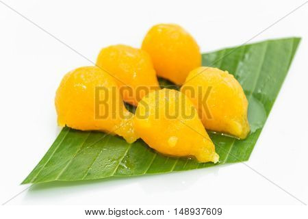 Egg yoke fudge balls cooked in syrup