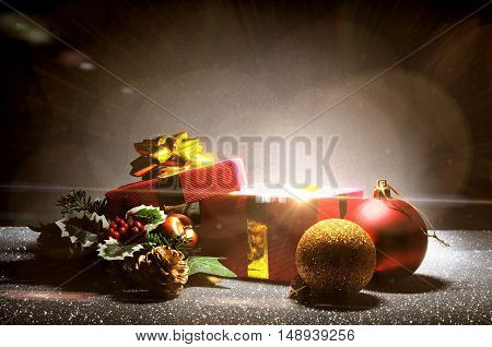 Christmas Composition With Gift And Glitter On Dark Background