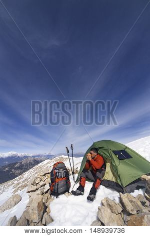 Camping on the top of the mountain in winter.