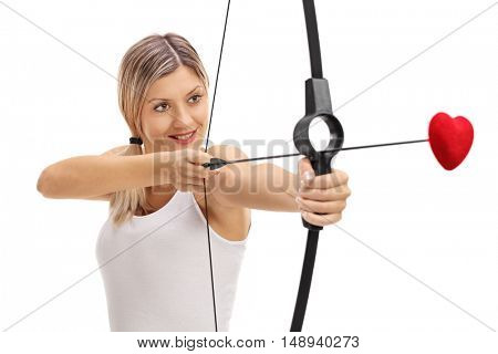 Girl aiming with a bow and a love arrow isolated on white background