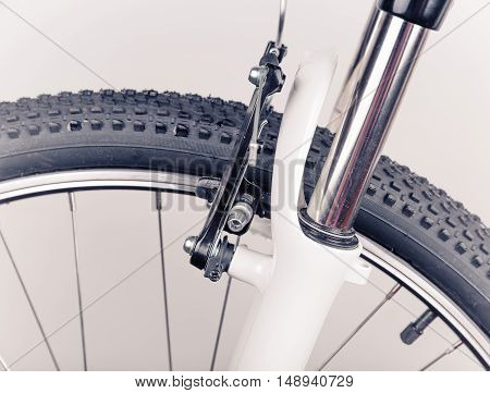 Bicycle wheel with black tire, close-up view
