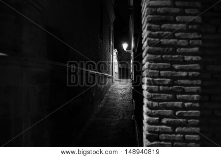 old city narrow streets at night time on black and white