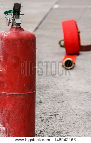 Watercourse fire extinguisher red ready to use in the outdoor.