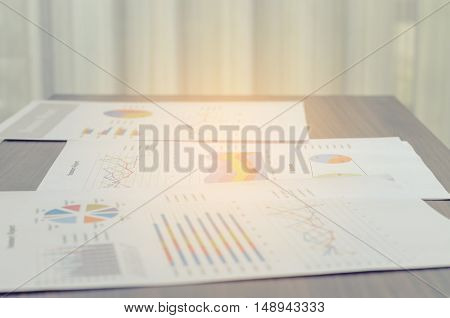 Business Documents Charts  On Wood Brown Table