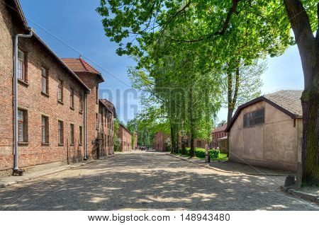 OSWIECIM POLAND - MAY 12 2016: Street in concentration camp Auschwitz-Birkenau in Oswiecim Poland.