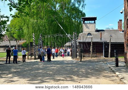 OSWIECIM POLAND - MAY 12 2016: Gate entrance to concentration camp Auschwitz with a sign Arbeit Macht Frei in Oswiecim Poland.