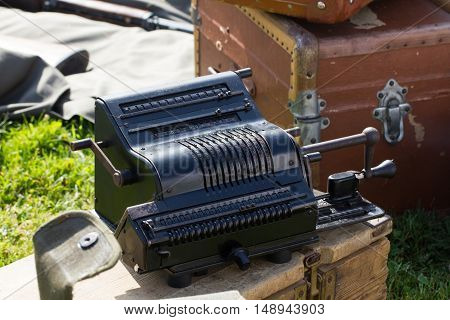 Old black mechanical calculator machine in metal