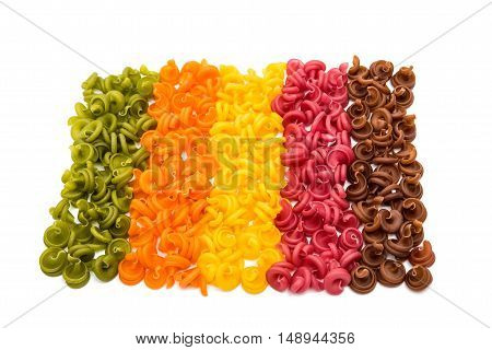 colored pasta italian food on white background