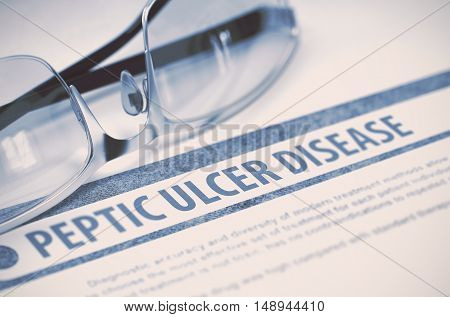 Peptic Ulcer Disease - Printed Diagnosis with Blurred Text on Blue Background with Eyeglasses. Medicine Concept. 3D Rendering.