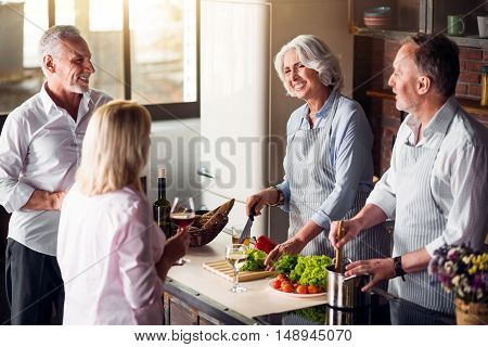 Good mood. Aged friends cooking, drinking good wine and laughing joyfully