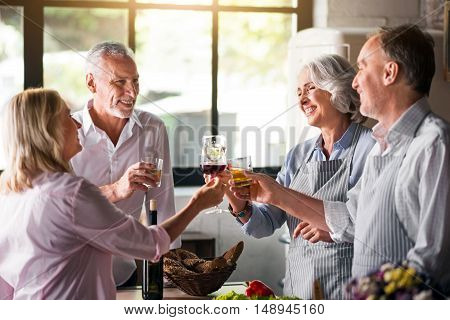 Together. Two middle-aged and and two female rasing glasses before party started