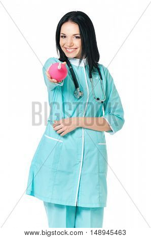 Young doctor holding pink enema. Portrait of beautiful young scientific researcher or woman doctor, isolated on white background.