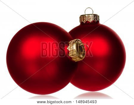 Big red baubles for christmas firtree on white background