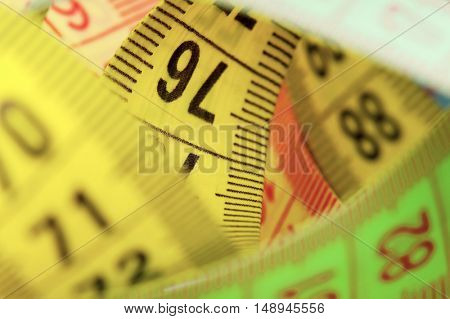 Close up of measuring tape of the tailor
