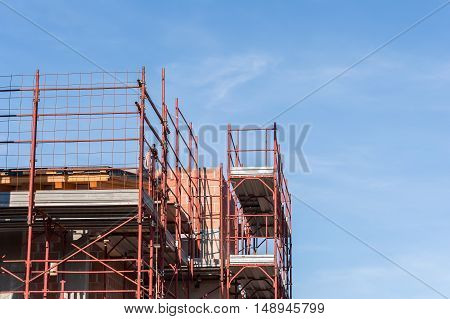 House under construction with the scaffolding for bricklayers